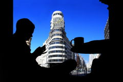 Silhuette of a man in Madrid, Callao. Stock Photo