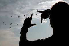 Silhuette med baloons arkivbilder