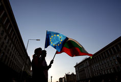 Silhuette of people holding Bulgarian and EU flags Royalty Free Stock Photography