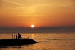 Silhuettes de coucher du soleil Images libres de droits
