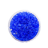 Silica gel. Blue silica gel on white background Stock Image