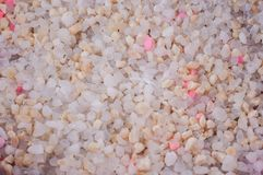Silica gel cat litter with white and pink granules in active use.  royalty free stock image