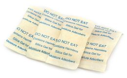 Silica gel. In small pack over white background Stock Image