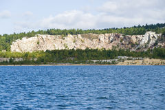 Silica Mine by the Lake. An exposed silica mine by the lake side Stock Images