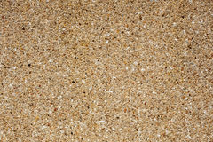 Silica sand on wall, texture Royalty Free Stock Photo