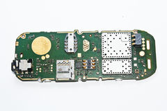 Silicon Board of a Cellphone. A photograph of the internal parts, the silicon board and components of a cellular phone Royalty Free Stock Photos