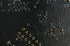 Silicon Computer Motherboard with Solder Close-up royalty free stock image