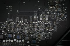 Silicon Motherboard with Soldered Circuits and Capacitors royalty free stock photo