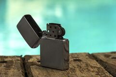 Free Silicon Petrol Lighter On A Wooden Background. Lighter Petrol Stock Photography - 186100082