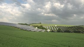 Silicon solar energy panels. On green corn field stock video footage
