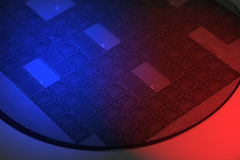 Silicon Wafer. Photographed with red and blue gells Royalty Free Stock Image
