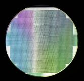 Silicon semiconductor wafer. Silicon wafer with chips  on black background Stock Photography