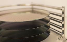 Free Silicon Wafers - A Wafer Is A Thin Slice Of Semiconductor Material, Such As A Crystalline Silicon, Used In Electronics For The Royalty Free Stock Image - 131526116