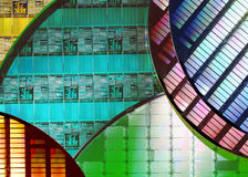 Silicon Wafers - Electronics. In electronics, a silicon wafer is a thin slice of semiconductor material, such as a silicon crystal, used in the fabrication of Stock Image