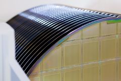 Free Silicon Wafers In White Plastic Holder Box On A Table- A Wafer Is A Thin Slice Of Semiconductor Material, Such As A Crystalline Royalty Free Stock Photography - 140598267