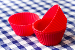 Silicone baking cups. The red  silicone baking cups Stock Photos