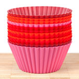 Silicone baking cups for muffins or cupcake. Pink, orange and red silicone baking cups for muffins or cupcakes Stock Image