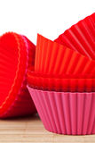 Silicone baking cups for muffins or cupcake. Pink, orange and red silicone baking cups for muffins or cupcakes Royalty Free Stock Photography