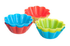 Silicone baking cups for muffins or cupcake. Orange, blue and green silicone baking cups for muffins or cupcake isolated on white background Stock Photo