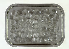 Silicone balls in a rectangular glass bowl Royalty Free Stock Image