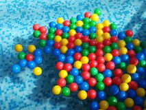 Silicone colored balls on the water Royalty Free Stock Images