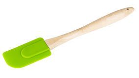Silicone kitchen spatula with wooden handle isolated on white Royalty Free Stock Photos