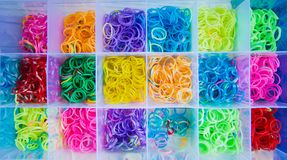 Silicone rubber bands in different colors for braiding bracelets. Child creativity, hobby, handmade. stock photos