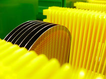 Silicone wafer. In a  yellow Carrier Stock Photos
