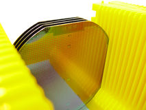 Silicone wafer. In a  yellow Carrier Royalty Free Stock Photo