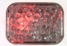 Siliconeballen in een rechthoekige glaskom Stock Fotografie