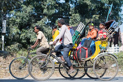 Siliguri transportation. SILIGURI, INDIA – DECEMBER 5, 2016: people travelling on rickshaws along the road of Siliguri Royalty Free Stock Image
