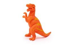Silikon- eller plast-dinosaurieleksak som isoleras på vit bakgrund Arkivbilder