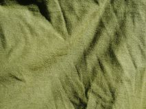 Картина предпосылки текстуры Шелк ткани хаки, зеленый, серый цвет поля Задрапируйте, drapery стоковое изображение rf