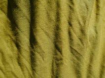 Картина предпосылки текстуры Шелк ткани хаки, зеленый, серый цвет поля Задрапируйте, drapery стоковое изображение