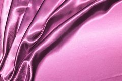 Silk. Beautiful folded violet silk background royalty free stock photography