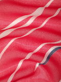 Silk. Red silk fabric texture suitable as background Stock Image