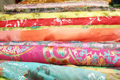 Silk. Stacks of Chinese printed and woven silk fabric on a local market in Beijing, capital of China Royalty Free Stock Image