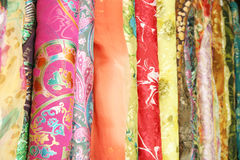 Silk. Stacks of Chinese printed and woven silk fabric on a local market in Beijing, capital of China Stock Photo