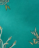 Silk background. Blue or turquoise oriental silk fabric background Royalty Free Stock Photo
