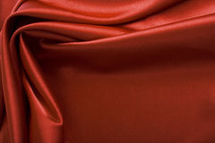 Silk background. Red silk background with riffle Stock Photo