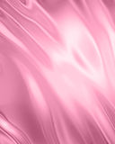Silk background. Pink silk or satin with some smooth folds in it Stock Photo