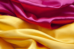 Silk background in pink and yellow colors Stock Images