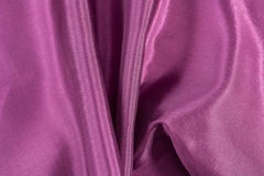 Silk background, texture of amaranth color  shiny fabric Royalty Free Stock Photography