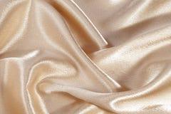 Silk background, texture of beige shiny fabric Stock Photo