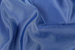 Silk background, texture of blue  shiny fabric, close up Stock Photo