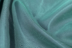Silk background, texture of green  shiny fabric Stock Images