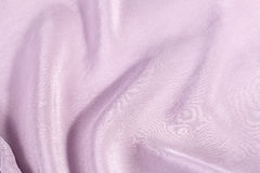 Silk background, texture of lilac shiny fabric Stock Photography