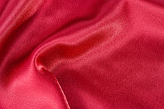 Silk background, texture of red  shiny fabric, close up Stock Photography