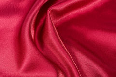 Silk background, texture of red shiny fabric Stock Photography