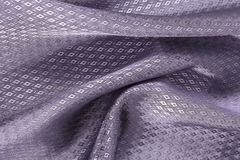 Silk background, texture of violet, diamond patern shiny fabric Royalty Free Stock Images